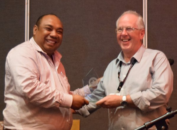 Hon. Jalta Wong MP PNG Minister of Police presents AARC Systems' Richard Wilson with the 2019 PNG Security Congress Award - Best Product on Show