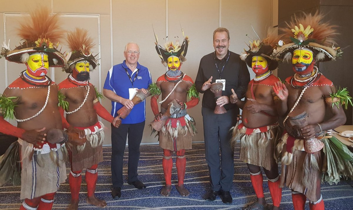 Richard Wilson, CEO of AARC Systems and Wayne Trethowan, General Manager of Consolidated Security Merchants being welcomed by PNG warriors in traditional dress